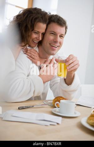 Loving couple having breakfast - Stock Photo