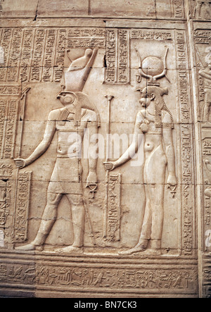 Bas relief alabaster carvings of  The falcon god Horus and mother Isis. The Temple of Horus and Sobek, Kom Ombo, - Stock Photo