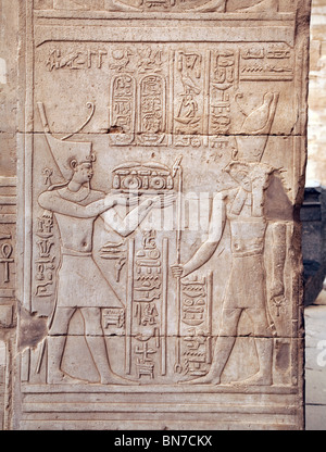 Bas relief alabaster carvings of the pharaoh presenting offerings to Horus. The Temple of Horus and Sobek, Kom Ombo, - Stock Photo