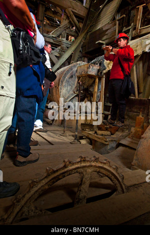 Tour Guide shows visitors the operation of the old copper mill in the Kennecott Mill Town, Wrangell St. Elias Park, - Stock Photo