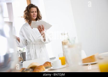 Woman getting bad news - Stock Photo