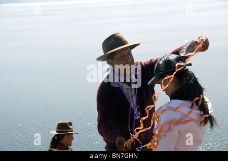 Traditional ceremony to thanks Pachamama for a good harvest - Stock Photo
