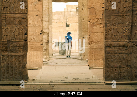 A Tourist looking at the Temple of Horus and Sobek, Kom Ombo, Upper Egypt - Stock Photo
