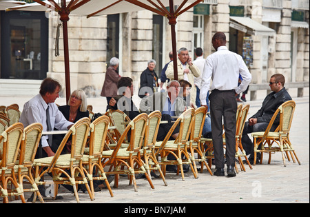 Guests in a street cafe in the Place Stanislas, Nancy, France - Stock Photo