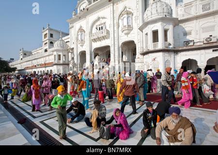 Sikh pilgrims. The Golden Temple. Amritsar. Punjab. India - Stock Photo