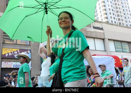 asian woman green umbrella