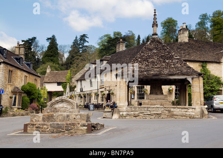 Market cross in the picturesque village of Castle Combe, Cotswolds, England taken on a fine day - Stock Photo
