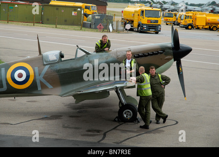 Spitfire and ground crew at Battle of Britain Memorial Flight, Coningsby, UK. - Stock Photo