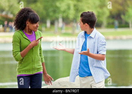 Multi ethnic racial racially diverse 14 15 16 year old Girl boy discuss discussion debate team young person people - Stock Photo