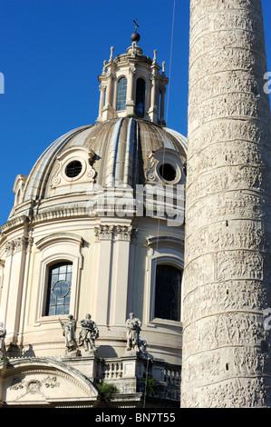 Trajans Column and Santissimo Nome di Maria al Foro Traiano just off Piazza Venezia in Rome, Italy - Stock Photo