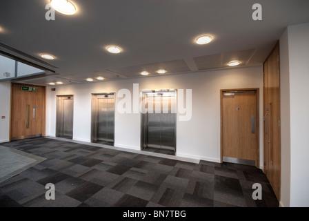 Lift doors in modern office reception area