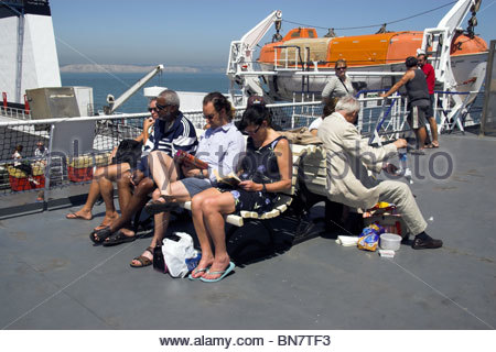 Passengers relaxing on the 'Norman Bridge' cross channel ferry operated by LD Lines, travelling the Dover to Boulogne - Stock Photo