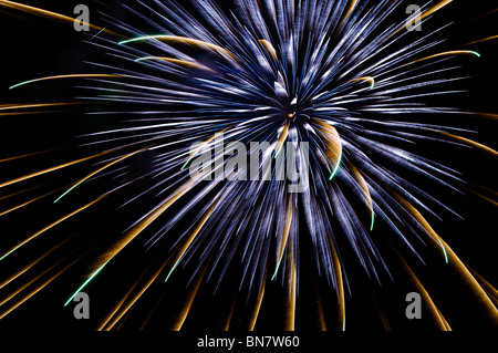 Light and color explode in a magnificent fireworks display over the sky of Tumwater, Washington on the 4th of July. - Stock Photo