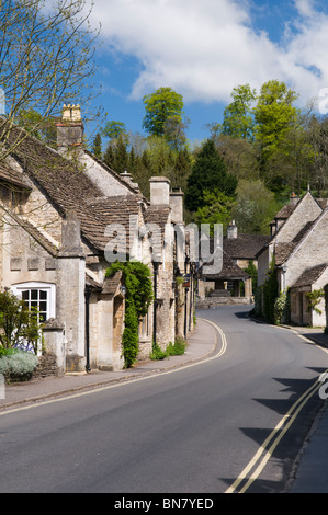 Main street in the picturesque village of Castle Combe, Cotswolds, England taken on a fine day - Stock Photo