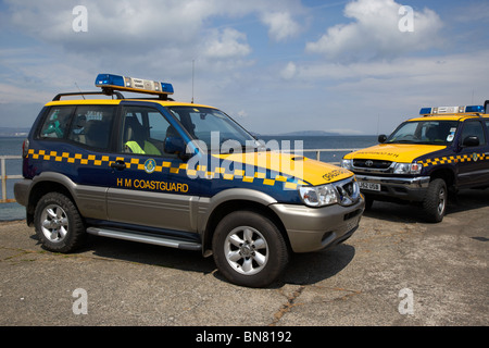 two HM Coastguard search and rescue 4x4 vehicles parked on a pier in the uk - Stock Photo
