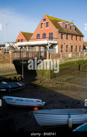 Quayside buildings of Emsworth, and Chichester Harbour at low tide. Emsworth. Hampshire. UK. - Stock Photo