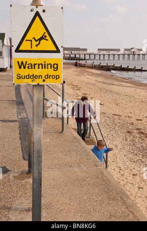 A warning sign of a sudden drop at Southwold , Suffolk , England , Great Britain , Uk - Stock Photo