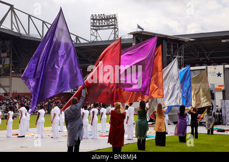 Dancers with flags at the 2010 London Global Day of Prayer. West Ham United Football Club, Upton Park, London, England. - Stock Photo