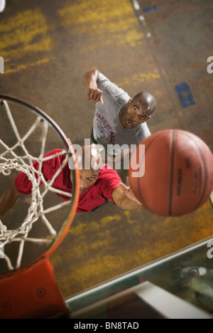Men playing basketball - Stock Photo