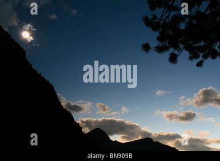 Mountain silhouette in time of the total Solar eclipse - Stock Photo