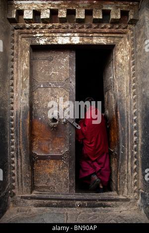 Monk in a doorway at Sera Monastery in Lhasa, Tibet - Stock Photo