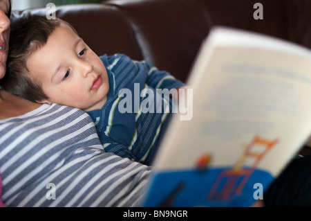Mother reading bedtime stories to child - Stock Photo