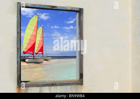 Formentera beach hobie cat Illetes view from aged vintage window - Stock Photo