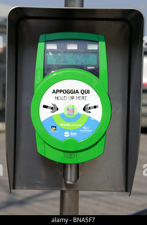 Automatic ticket machine used to validate tickets before boarding the ACTV vaporetto water bus Lido Venice Italy - Stock Photo