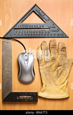 Computer mouse and old tools placed to resemble a house - Stock Photo