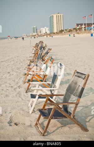 Beach chairs on the beach in Myrtle Beach, SC. - Stock Photo