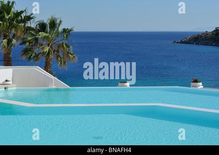 Mykonos. Greece. Infinity pool at Hotel Mykonos Blu, Psarou Beach. - Stock Photo
