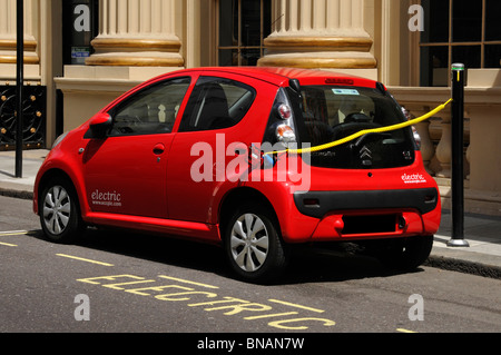 Air pollution & environment issues may make electric car charging via a public charging station a more common site - Stock Photo