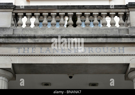 Close up of sign above main Knightsbridge entrance to Lanesborough Hotel 5 stars expensive luxury hotel with stone - Stock Photo
