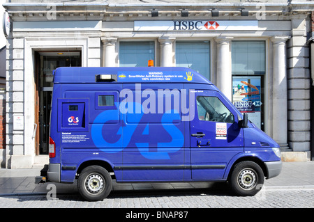 Group 4 Securicor van parked in shopping high street - Stock Photo