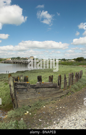 The Old Toll Bridge across the River Adur with a wreck in the foreground - Shoreham-By-Sea, West Sussex. - Stock Photo