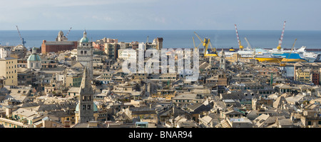 Panoramic view of Genoa with the characteristic old houses and port - Stock Photo