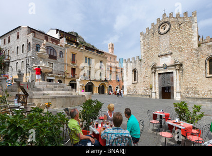 Sidewalk cafe in front of the Duomo (Cathedral), Taormina, Sicily, Italy - Stock Photo
