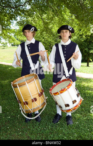 Two young drummers in period uniforms recall American Revolutionary War days during the 1780s at Yorktown Battlefield - Stock Photo
