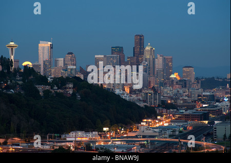 Retro Image of Seattle skyline with moon rising over city. - Stock Photo