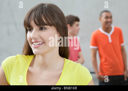 Young woman and two young men - Stock Photo