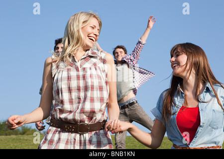 Friends having fun outdoors - Stock Photo