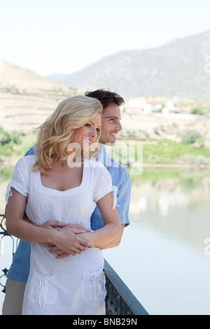 Couple on balcony overlooking douro river - Stock Photo