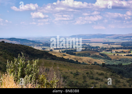 Distant farmlands in the foothills of the Drakensberg, Midlands, KwaZulu Natal, South Africa. - Stock Photo