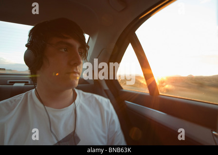 Boy traveling in back seat of car - Stock Photo