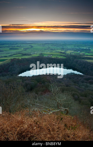 Winter Sunset over Lake Gormire and the Vale of Mowbray, North Yorkshire - Stock Photo