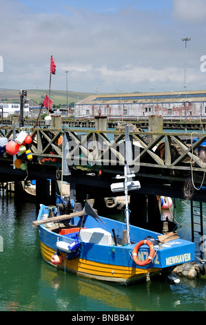 Small fishing boat in harbour, West Quay, Newhaven, Lewes District, East Sussex, England, United Kingdom - Stock Photo
