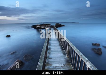 Jetty at Pans Rocks on Antrim coast. Northern Ireland. - Stock Photo