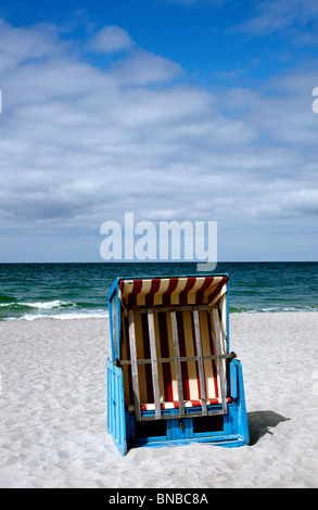 Strandkorb (beach chair) at a Baltic Sea beach in Ahrenshoop on the Darß peninsula of Mecklenburg-Vorpommern in - Stock Photo
