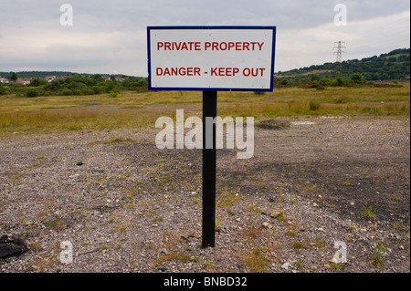 PRIVATE PROPERTY DANGER KEEP OUT sign on former coal mine workings at The British Torfaen South Wales UK - Stock Photo