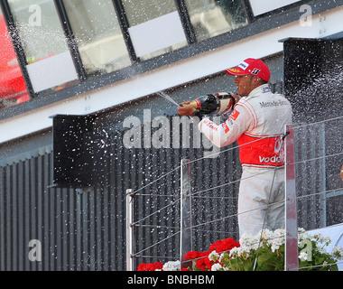 Lewis Hamilton celebrating his second place finish at the British Formula One Grand Prix, Silverstone, 11.7.2010 - Stock Photo